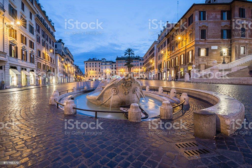 Barcaccia fountain in Piazza di Spagna by night, Rome, Italy stock photo