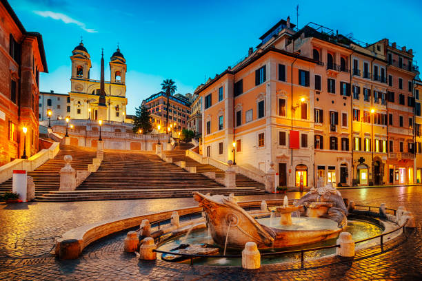 Fontana della Barcaccia in Piazza di Spagna with Spanish Steps Fontana della Barcaccia and Spanish Stepsat night in Rome rome italy stock pictures, royalty-free photos & images