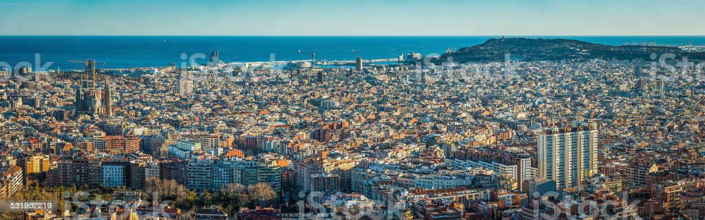 Barcelona aerial panorama over landmarks and rooftops to Mediterranean Spain stock photo