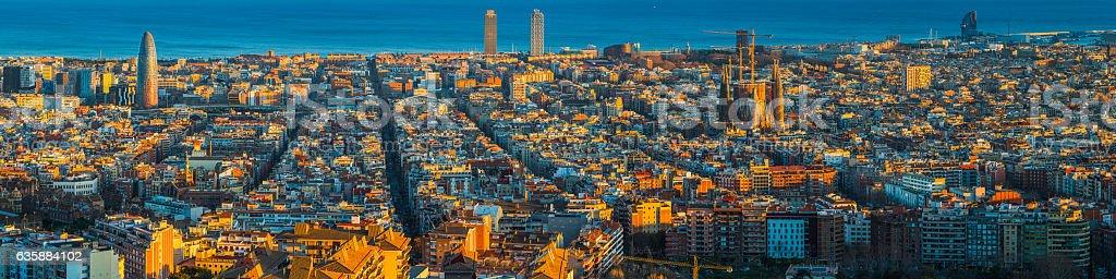 Barcelona aerial panorama over Mediterranean sunset landmarks Sagrada Familia Spain stock photo