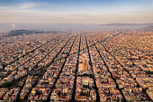 Aerial view of Barcelona with Diagonal Avenue and square blocks and Sagrada Familia