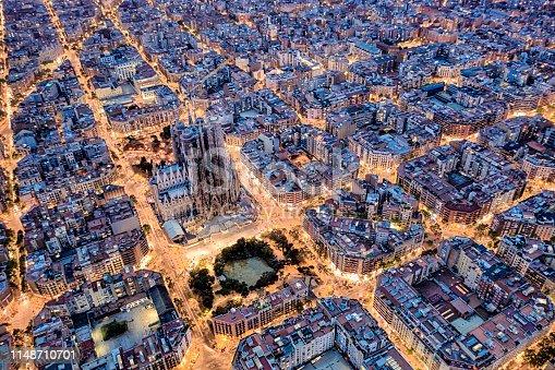 Aerial view of Barcelona with Diagonal Avenue and square blocks and Sagrada Familia