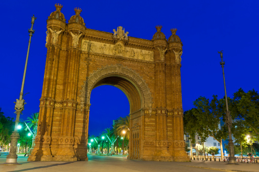 Barcelona Arc de Triomphe illuminated blue dusk Ciutadella Catalonia Spain