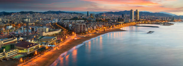 Barcelona beach on morning sunrise with Barcelobna city and sea from the roof top of Hotel stock photo
