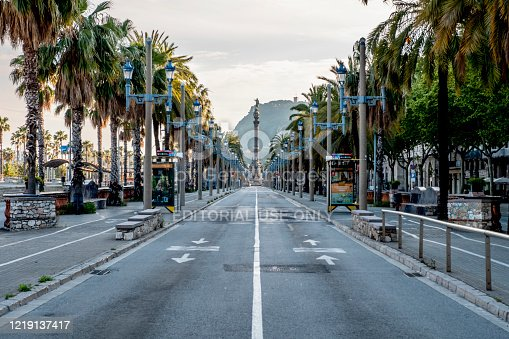 Barcelona, Catalonia / Spain: 04 09 2020: Paseo marítimo with colon statue in empty streets in the city of Barcelona during the covid-19