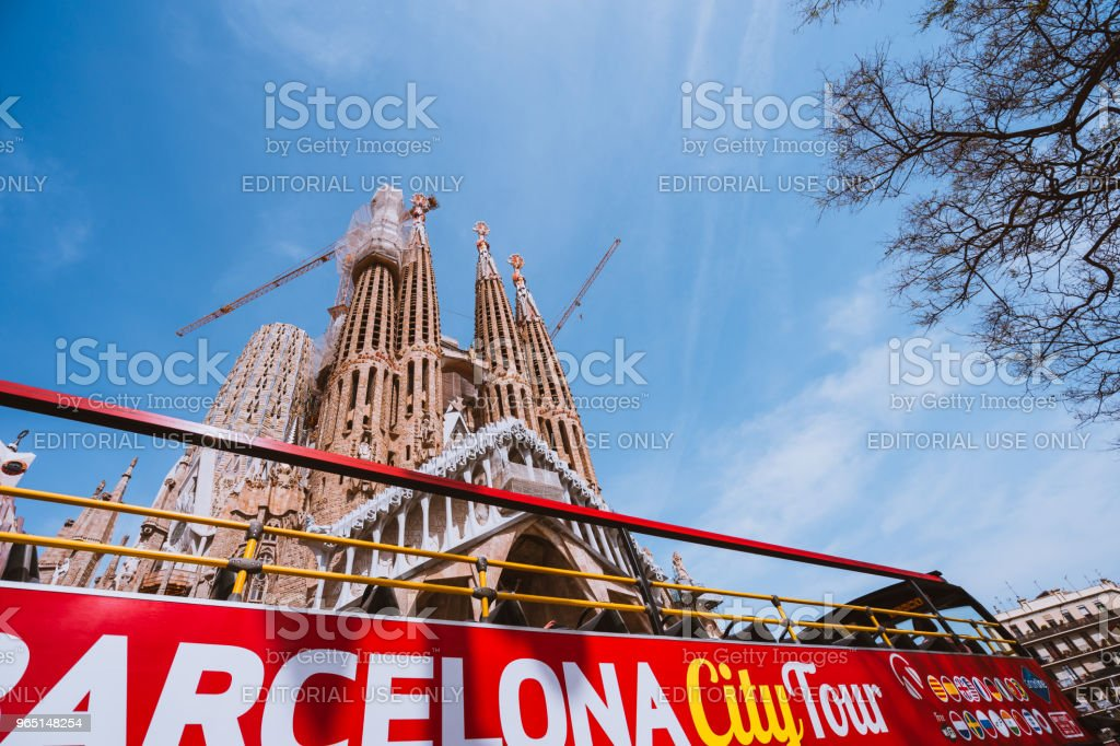 Barcelona city tour touristic bus in front of famous Sagrada Familia Basilica yet not finished work of Catalan architect Antoni Gaudi zbiór zdjęć royalty-free