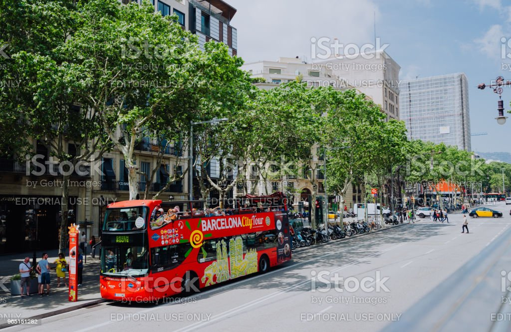 Barcelona city tour touristic bus with tourists on the route around Barcelona, Spain royalty-free stock photo