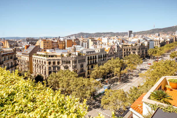 Barcelona city view Top view on Gracia avenue with luxurious buildings in Barcelona city passeig de gracia stock pictures, royalty-free photos & images