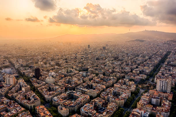 Barcelona Cityscape Eixample, Gran Via Aerial cityscape of Barcelona at Saint Joan Avenue, Eixample neighborhood barcelona spain stock pictures, royalty-free photos & images
