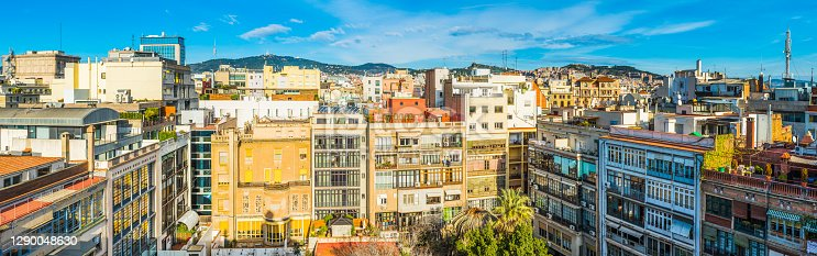 Panoramic view over the crowded cityscape across the rooftops of central Barcelona, Spain.