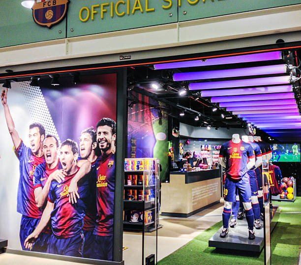 "Barcelona Football Club Official Fan Store, Spain ""Barcelona, Spain  - October 13, 2012: Barcelona Football Club Official Fan Store in Barcelona Airport, Spain"" fan club stock pictures, royalty-free photos & images"