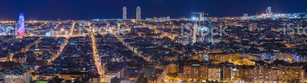 Barcelona illuminated cityscape panorama Sagrada Familia Torre Agbar Mediterranean Spain stock photo
