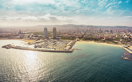 Barcelona skyline aerial view with skyscrapers by the beach, Spain