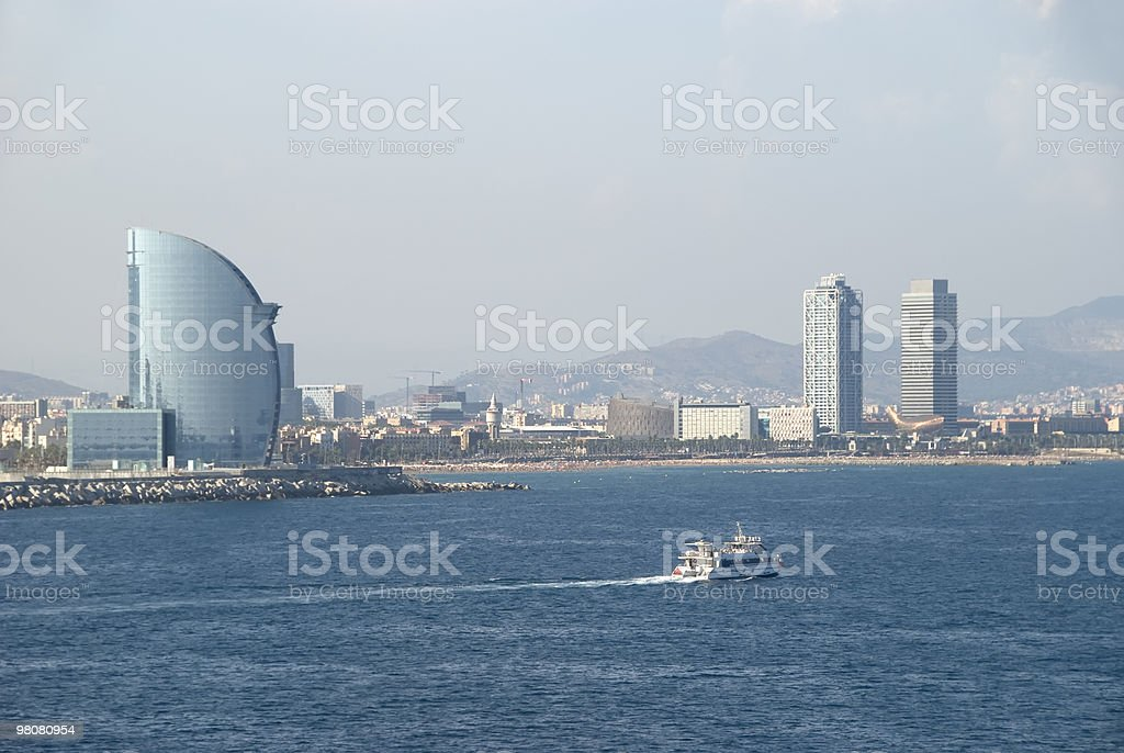 Barcelona skyline with a passenger ship royalty-free stock photo