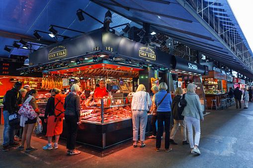 Barcelona, Spain - 20 April, 2016: People shop In Barcelona. Market Mercat de Sant Josep de la Boqueria