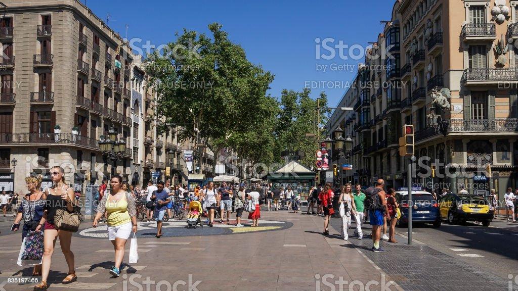 Barcelona, Spain - July 24 2017:Juan Miro mosaic with crowd on La Rambla area. stock photo
