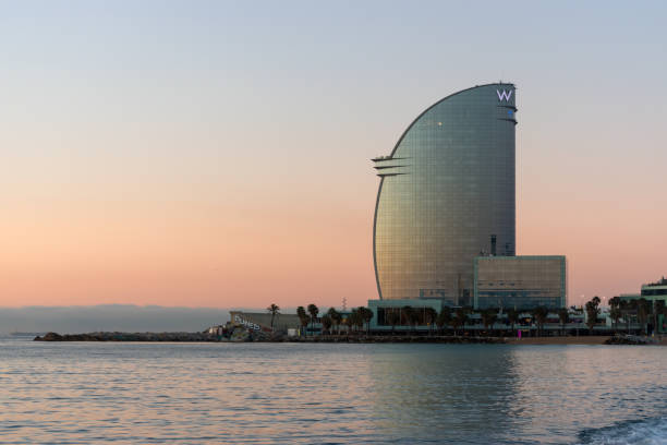 Barcelona, Spain -March 17, 2019: View of Barceloneta Beach and W Hotel in Barcelona, Spain. Barcelona, Spain -March 17, 2019: View of Barceloneta Beach and W Hotel in Barcelona, Spain. letter w stock pictures, royalty-free photos & images