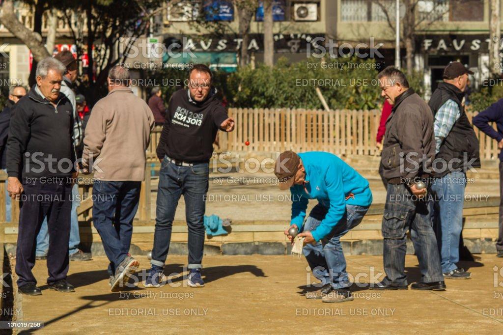 Barcelona, Spain, March 2018:  Locals elders play pitanque near Sagrada Familia stock photo