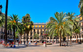 'Barcelona, Spain - August 16, 2011: Plaza Real in Barcelona, Spain. On the square, with lanterns designed by Gaudi, are many restaurants and some of the city\\'s most famous clubs'