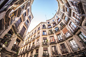 A view looking up on the apartments in Barcelona on a sunny afternoon near Placa Reial