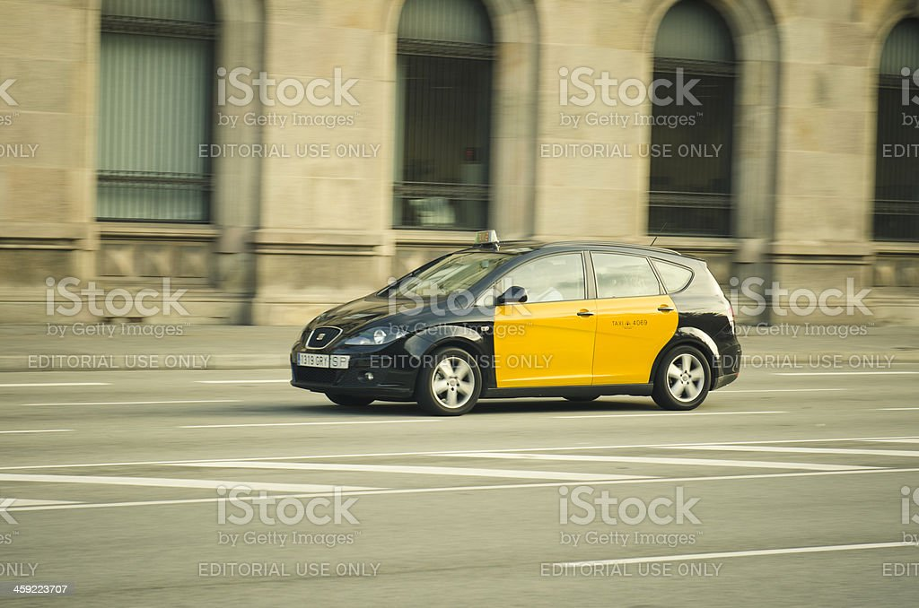 Barcelona taxi cab running fast royalty-free stock photo