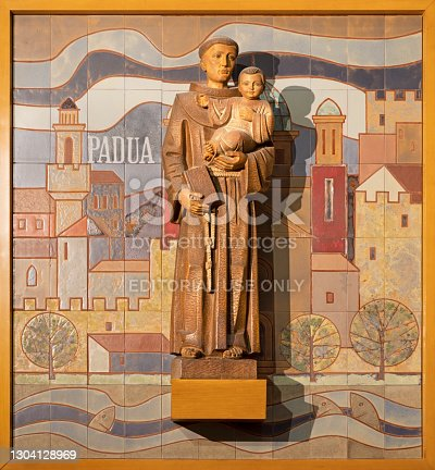Barcelona - The carved statue of St. Anthony with the terracotta background in the chruch Iglesia de Belen.