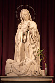 BARCELONA, SPAIN - MARCH 3, 2020: The marble sculpture of Madonna over the crib in the chruch Iglesia de Belen by Joan Rebull.