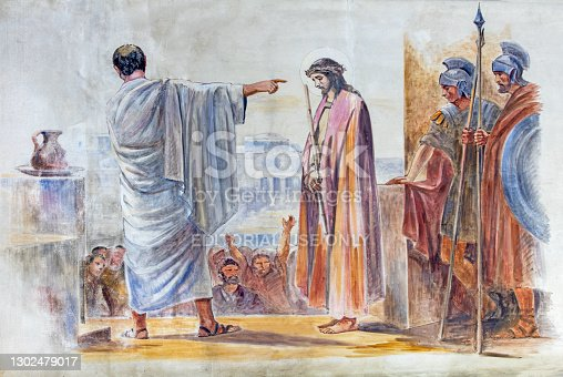 istock Barcelona - The modern fresco Jesus before Pilate in the atrium of church Església de la Concepció from 19. cent. 1302479017