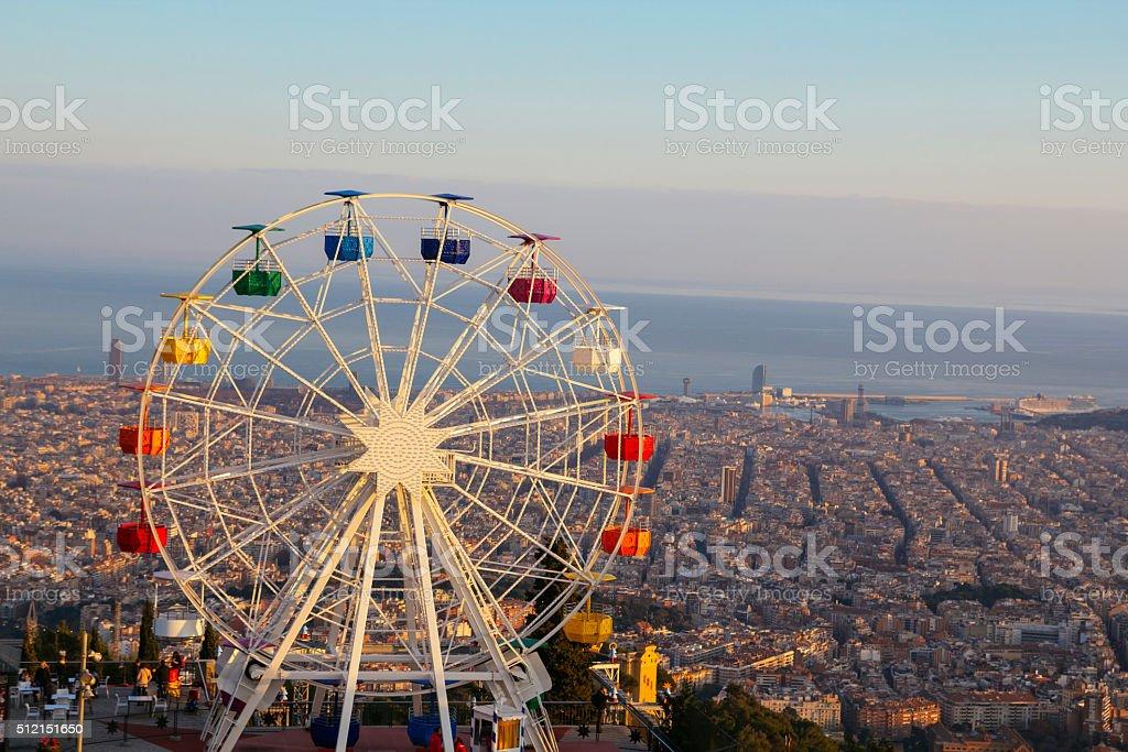 Barcelona, Tibidabo amusement park with ferris wheel Ferris wheel on top of the city, at Tibidabo, Barcelona Above Stock Photo