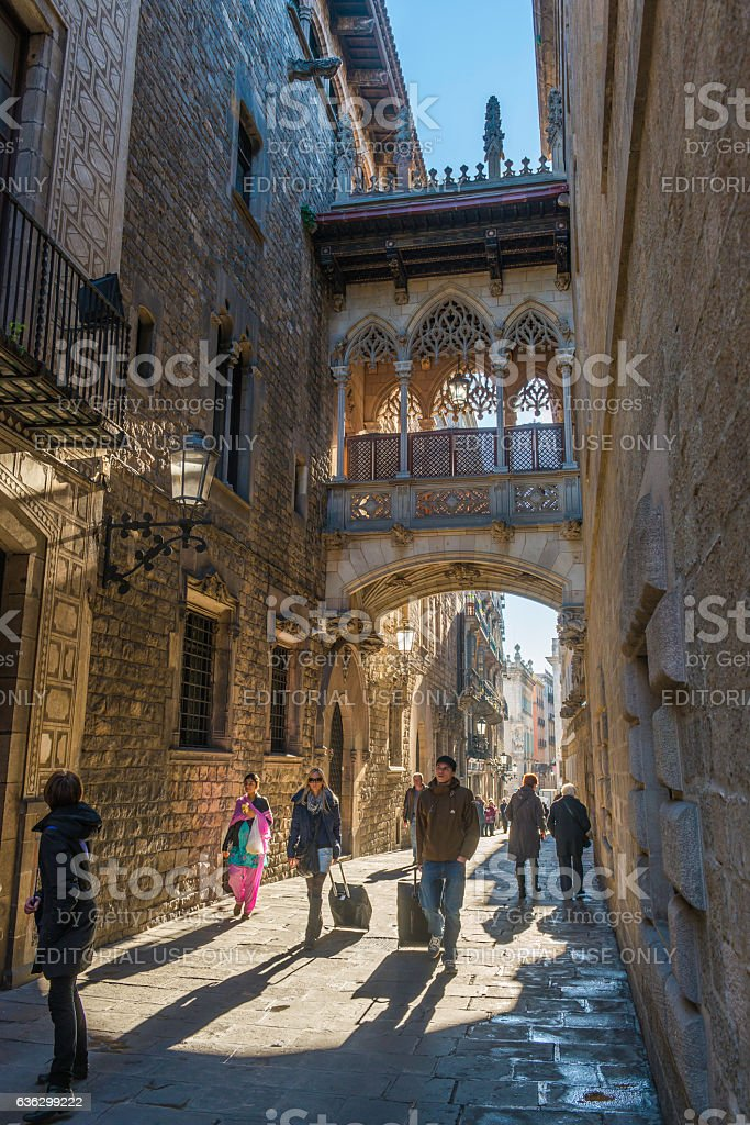 Barcelona tourists walking through the Gothic Quarter old town Spain stock photo