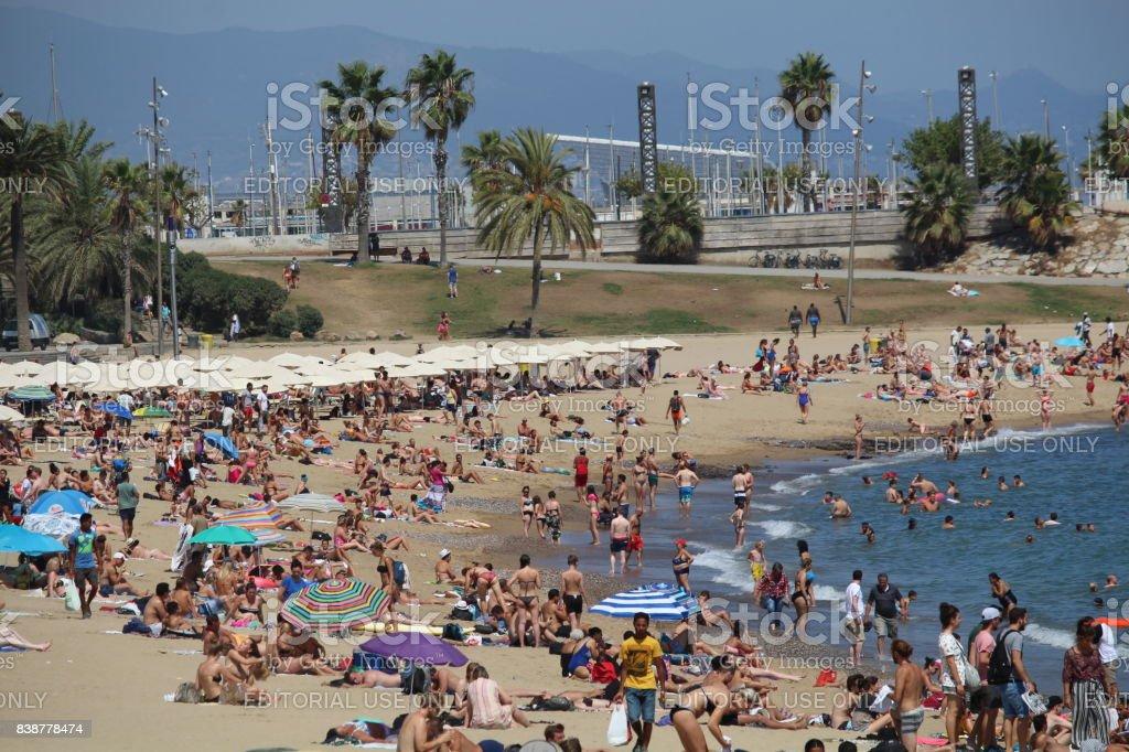 Barceloneta beach crowd stock photo