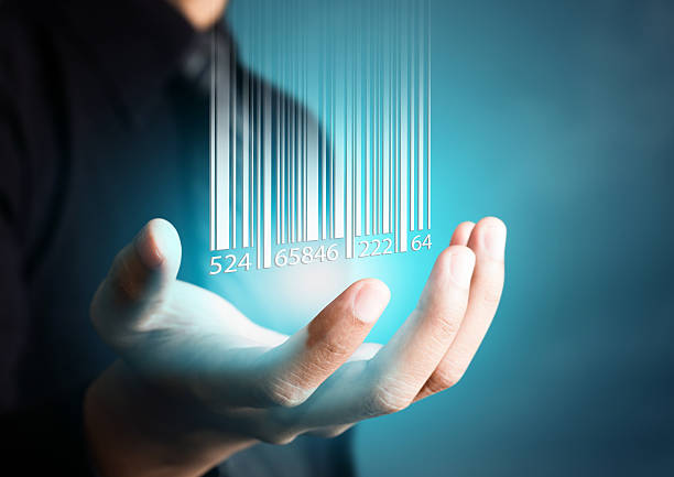 Barcode dropping on businessman hand stock photo