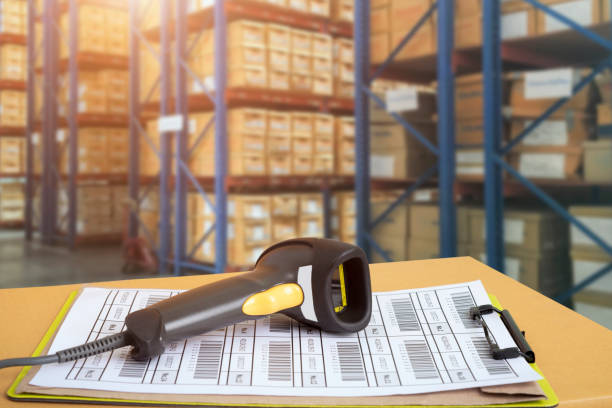 Barcode scanner in front of modern warehouse and scanning code stock photo