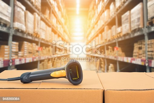 istock Barcode scanner in front of modern warehouse 948369364