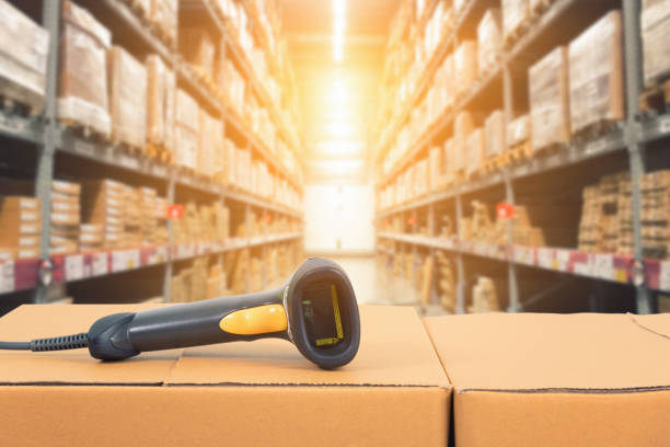 Barcode scanner in front of modern warehouse stock photo