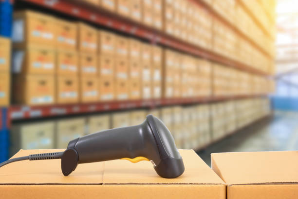 barcode scanner in warehouse stock photo