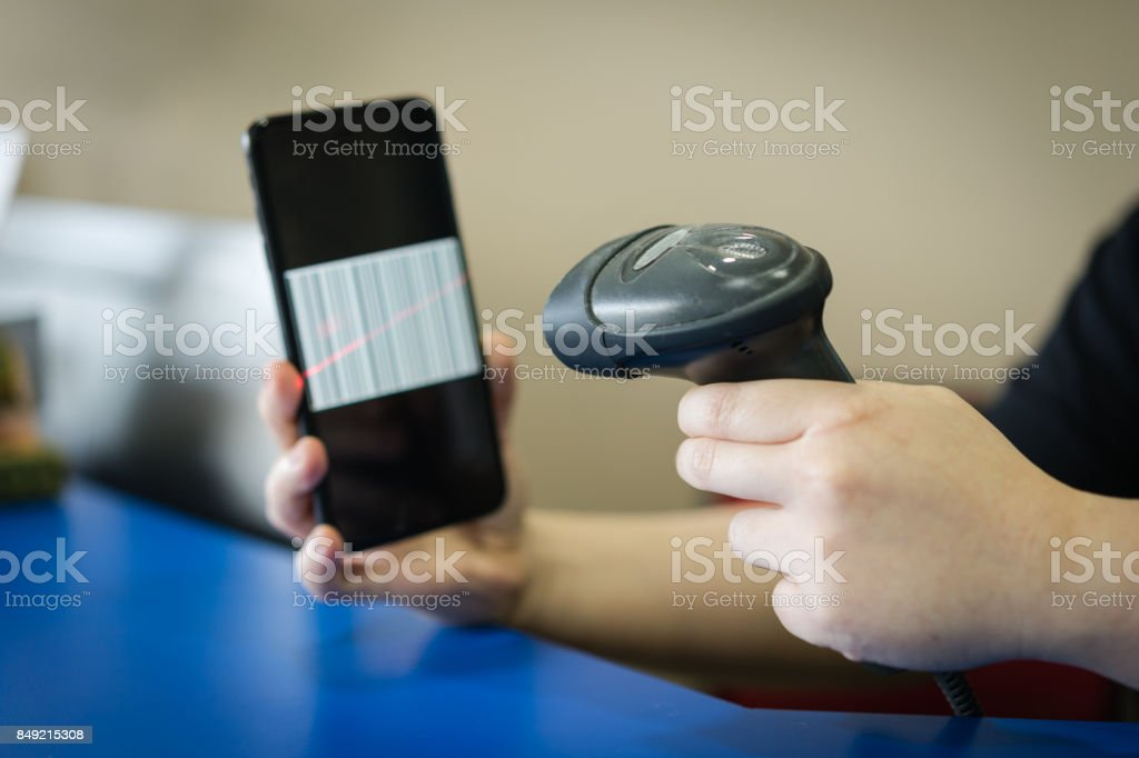 A Barcode Scanner Scanning A Barcode On A Mobilecellular Phone
