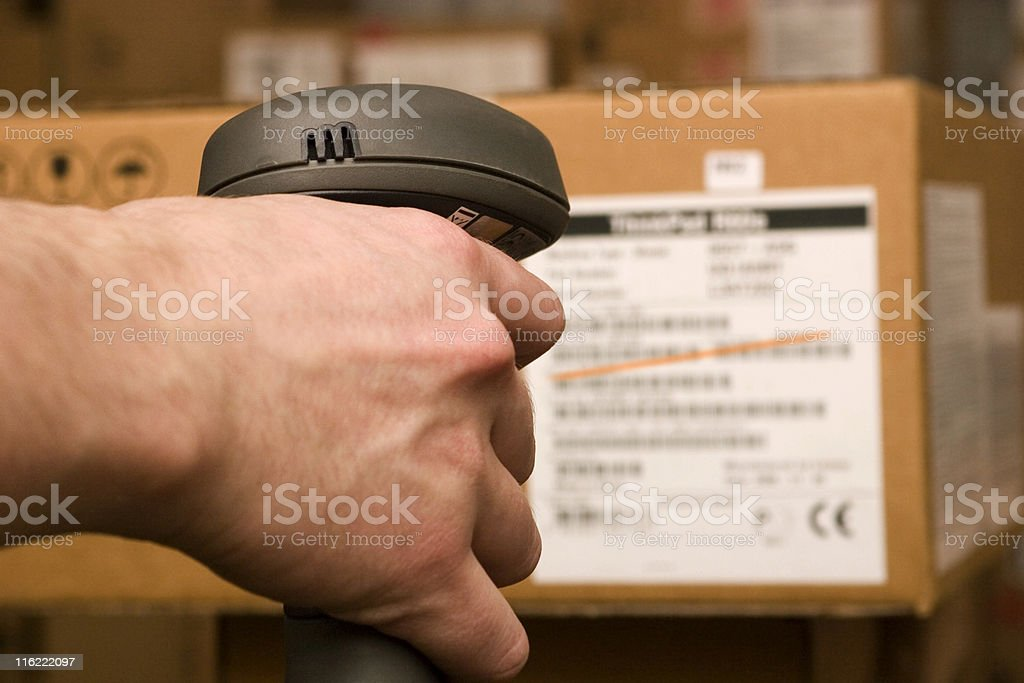 A barcode scanner scanning a package stock photo
