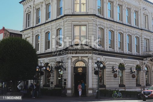 Victoria, Canada - June 11, 2019. Building exterior of Bard and Banker, a pub, in a classic building in downtown Victoria.