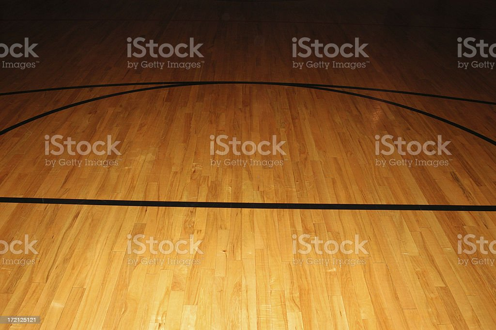 Bare basketball wood floor with black court lines royalty-free stock photo