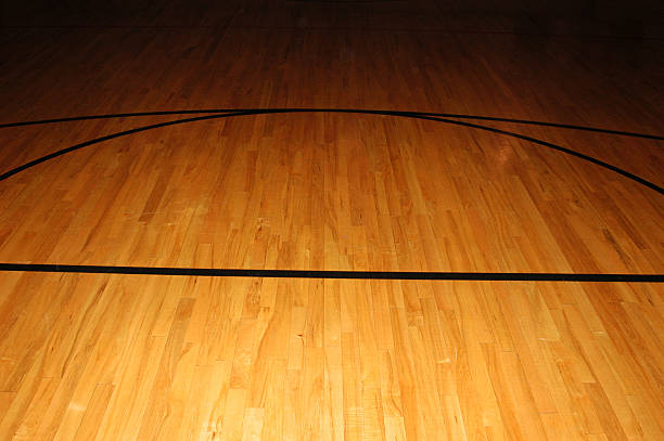 Royalty Free Basketball With Dark Background On A Wood Gym Floor
