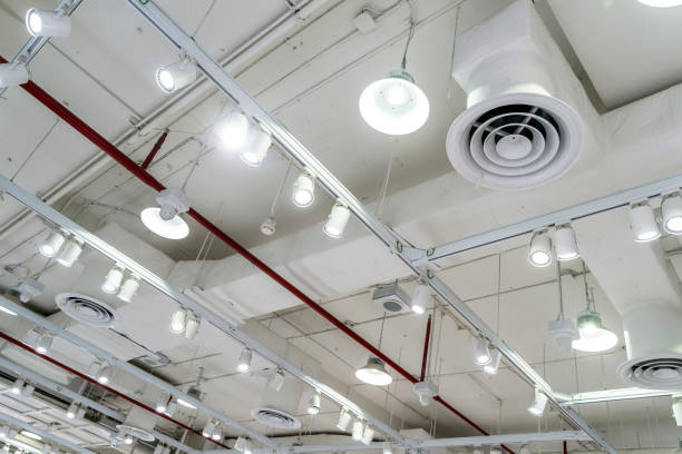 Bare ceiling with air duct, CCTV, air conditioner pipe and fire sprinkler system on white ceiling wall. Air flow and ventilation system. Ceiling lamp light with opened light. Interior architecture. Bare ceiling with air duct, CCTV, air conditioner pipe and fire sprinkler system on white ceiling wall. Air flow and ventilation system. Ceiling lamp light with opened light. Interior architecture. air duct stock pictures, royalty-free photos & images