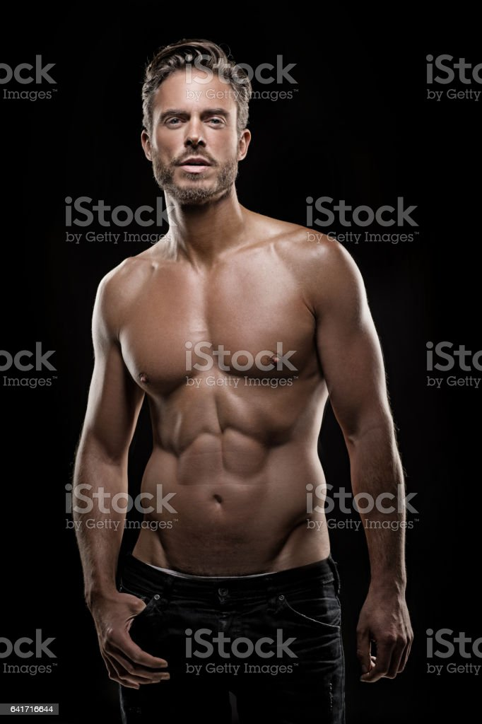 Bare chested handsome male posing for studio shot stock photo