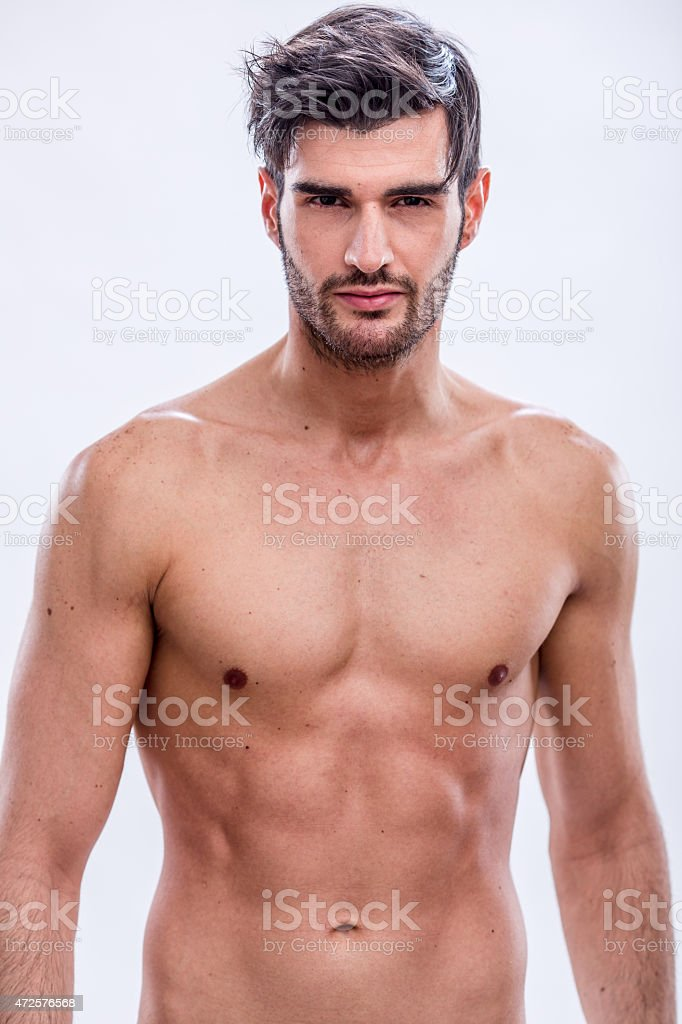 Bare chested male model with dark hair, mustache and goatee stock photo