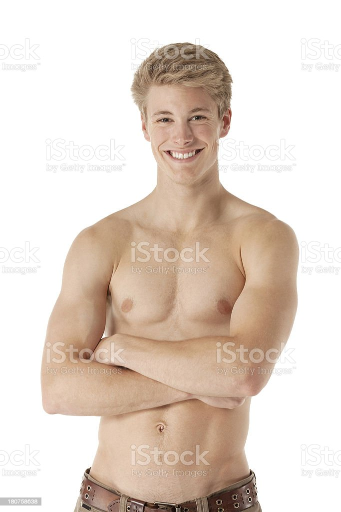 Bare chested man standing with arms crossed royalty-free stock photo