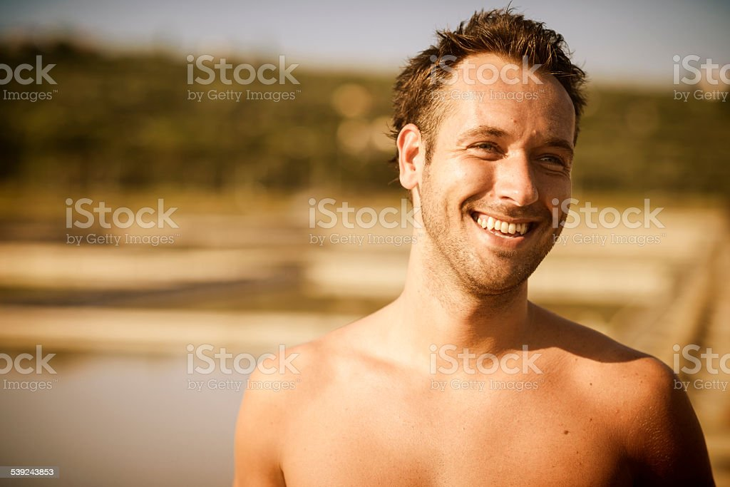 Bare Chested Man Taking a Break Outdoors in Summer royalty-free stock photo