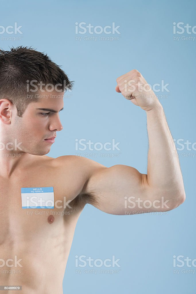 A bare chested man wearing a badge royalty-free 스톡 사진
