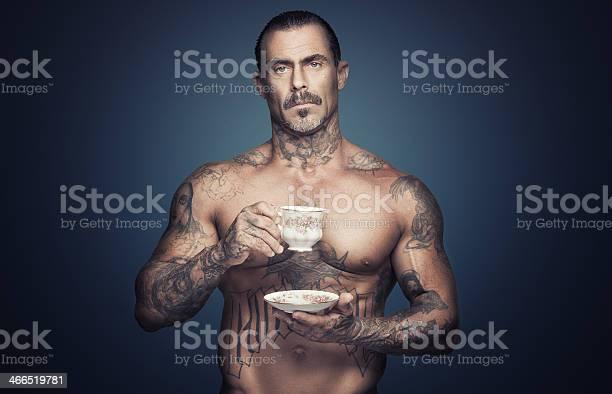 Bare chested man with tattoos holding a cup of tea picture id466519781?b=1&k=6&m=466519781&s=612x612&h=stzxuni0qlaxulsxslmiwjhdqfmwk2eldqqglqlncek=