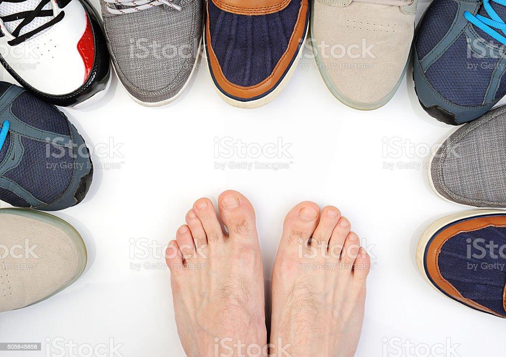 bare feet beetwen shoes stok fotoğrafı