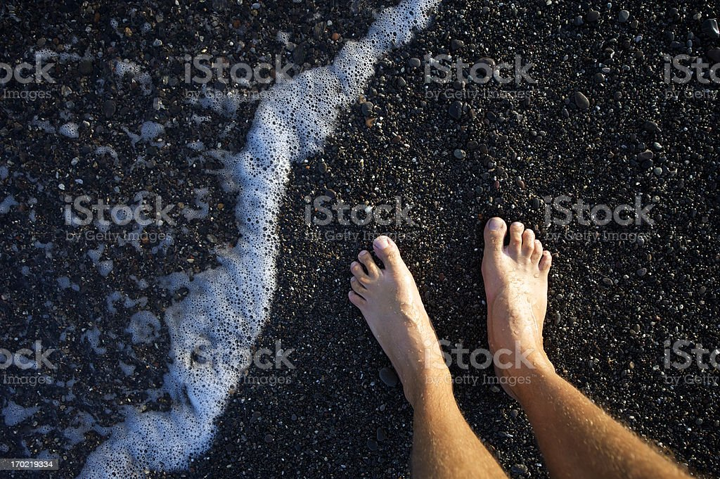 Bare Feet Black Pebble Sand Beach Wave stock photo